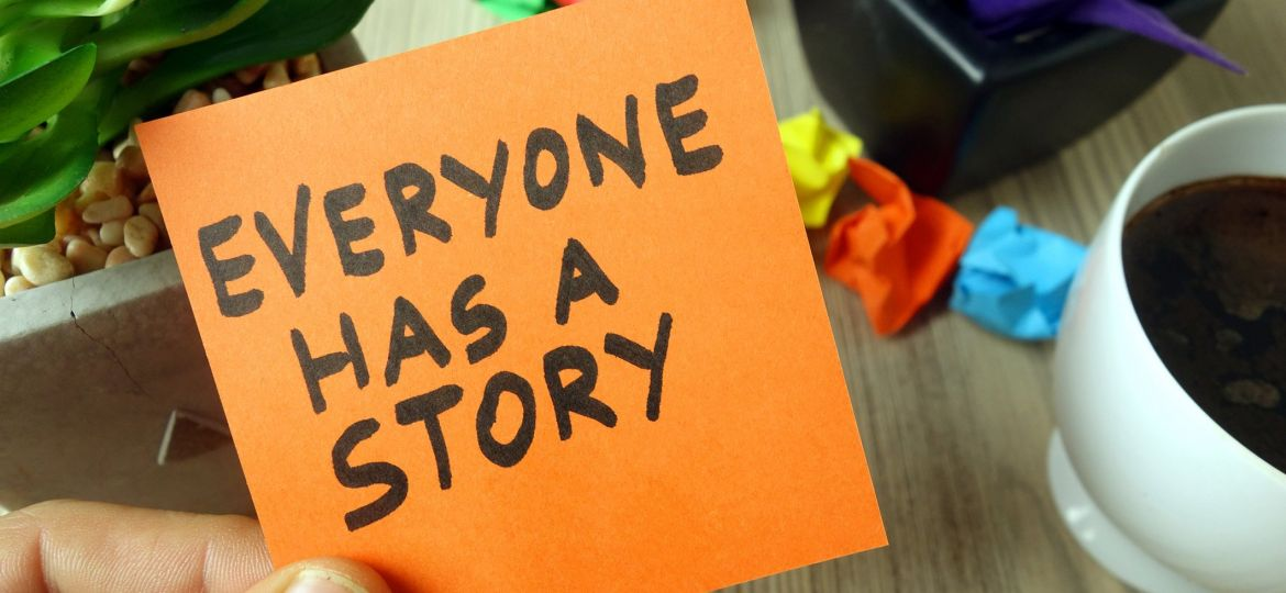 Slogan everyone has a story handwritten on sticky note