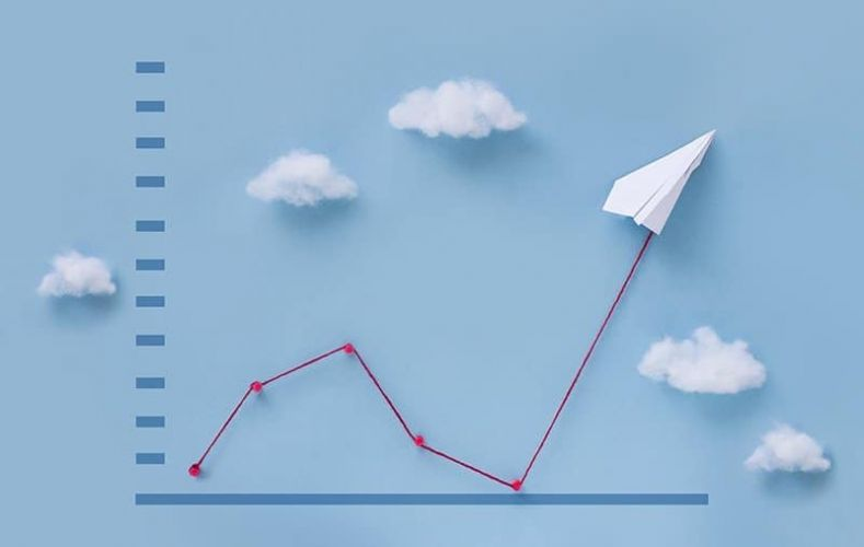 Conceptual paper plane pulling business finance growth chart still life image.